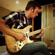 Roy Harrill playing the Chestnut Strat by Harrill Guitars.