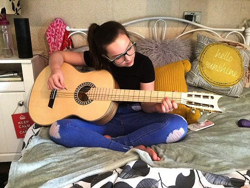 Neve Harrill playing Flamenco 2 by Harrill Guitars.