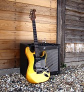 Gold Stratocaster by Harrill Guitars.