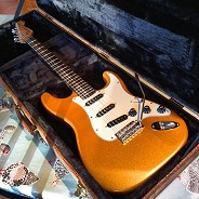 Gold Stratocaster with original white scratch plate by Harrill Guitars.